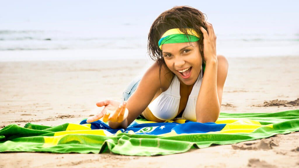 Brazilian girl with Flag at Ipanema Beach