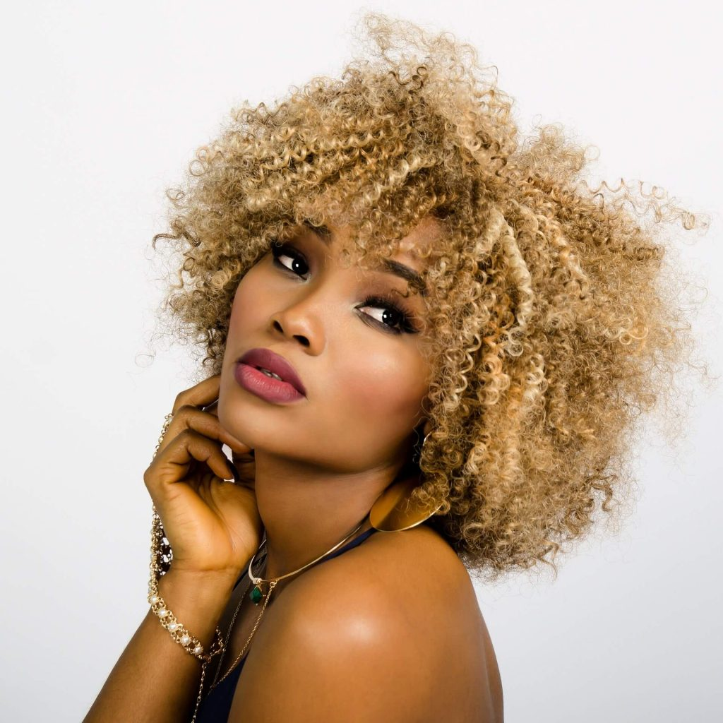 Exotic Brazilian Woman with blonde curled hair